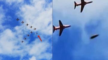 НЛО пролетает мимо истребителей во время авиашоу